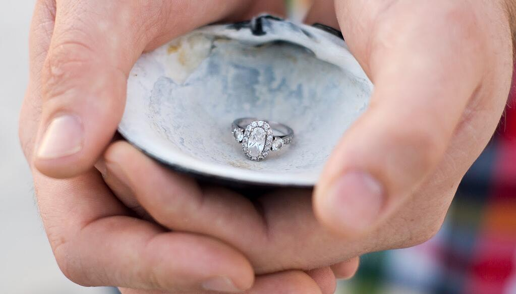 ring in shell - when to book wedding photographer.jpg