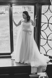 Bridal shot of bride on big window sill.jpg