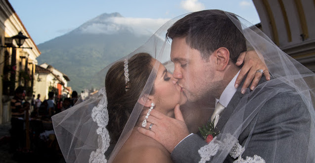 wedding couple kissing under veil in guatemala